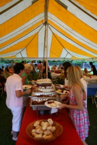 A delicious buffet under the striped tent.