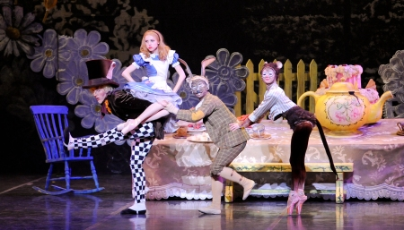Alice pouts as the Cooper Verona (Mad Hatter), Masahiro Haneji (March Hare) and Diana Yohe (Dormouse) cavort.